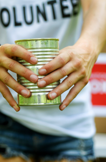 volunteer with can in hand